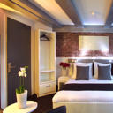 Hotel CC features boutique-style rooms with air conditioning in 3 picturesque historic buildings. It is 350 metres from Amsterdam Central Railway Station which offers tram and metro connections.